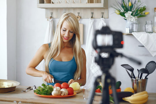 Healthy eating. Dieting and people concept. Blonde recording a video blog