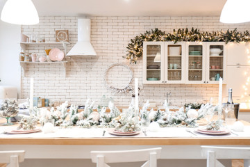 Beautiful table setting for Christmas celebration in kitchen