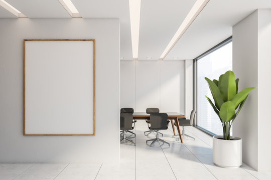 White panel conference room with poster