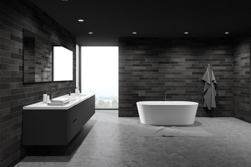 Dark tile spacious bathroom interior, tub and sink