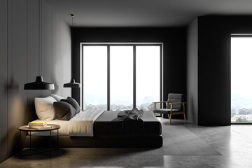 Gray master bedroom with armchair, side view
