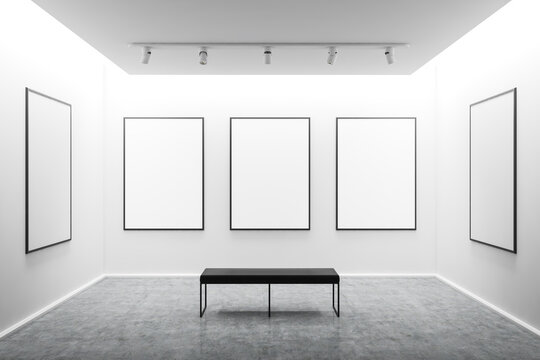 White art gallery interior with mock up posters