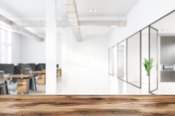 Table in blurry white industrial style office