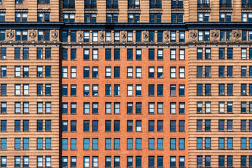 Brown Brick high building facade with windows in New York City, United states of America, USA, Industrial Background and texture, Loft inspiration. Construction facade, history and culture concept
