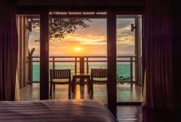 Foto op Aluminium Zee zonsondergang Ocean sunset view from bedroom balcony for travel concept.