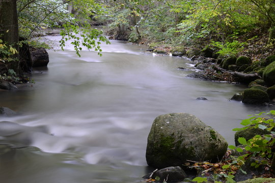 Long exposure stillwater river stone