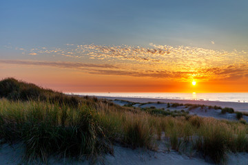 Sunset at the beach on Juist, East Frisian Islands, Germany.