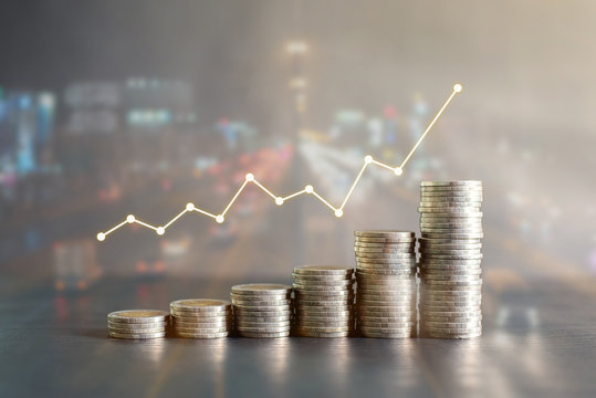 Double exposure stack of Thailand coins on black wooden table with profit graph, growth up, success on blur background of night road. Business, finance, marketing, e-commerce concept and design
