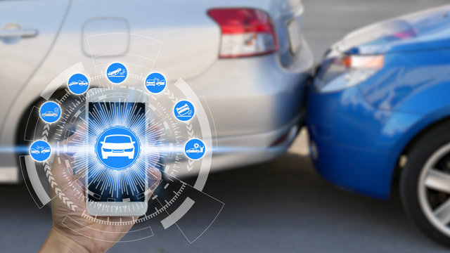 Hand use smartphone with car claim icons over the Network connection on car crash background, car accident for car insuranc claim concept
