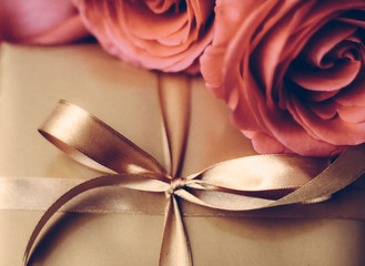 Luxury holiday golden gift box and bouquet of roses as Christmas, Valentines Day or birthday present