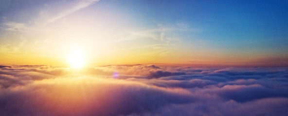 Beautiful sunrise cloudy sky from aerial view Fotobehang