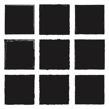 A group of empty labels with uneven rough edges drawn with an ink brush