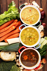 Foto auf Leinwand Braun Set of soups from worldwide cuisines, healthy food. Broth with noodles, beef soup and broth with marrow dumplings. All soups with healthy vegetables on table