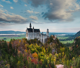 Amazing view of Neuschwanstein castle in autumn season at sunset. Bavaria, Germany. Neuschwanstein castle one of the most popular palace and travel destinations in Europe and the world.