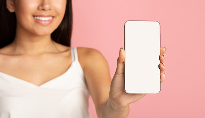 Mockup for app. Girl showing phone empty screen to camera