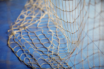 Shallow depth of field (selective focus) image with a goal net inside a sports arena.