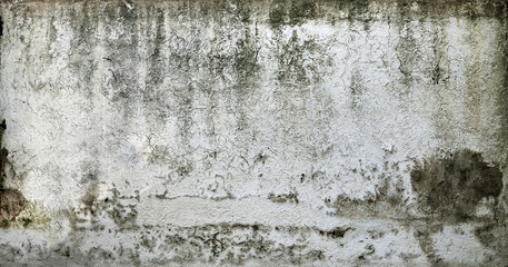 Old chipped white wall texture with moisture - dirty and creepy pattern for background