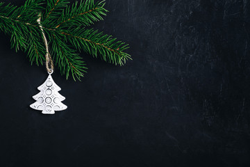 Christmas background with fir branch and christmas tree.
