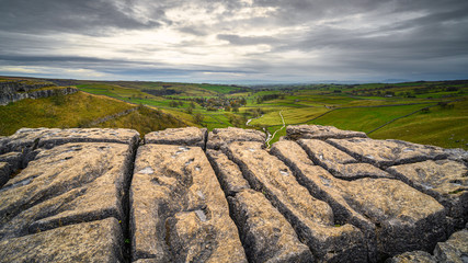 Malham Village below Malham Cove, in Malhamdale which has extensive Limestone Pavement at the top where the Pennine Way passes by
