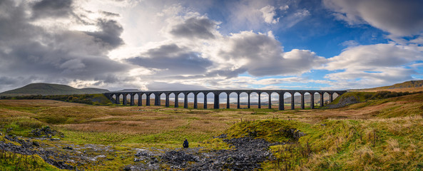 Panorama of Ribblehead Viaduct, which carries the Settle to Carlisle Railway across Batty Moss spanning 400 m and 32 m above the valley floor