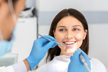 Smiling woman looking with trust at dentist during treatment