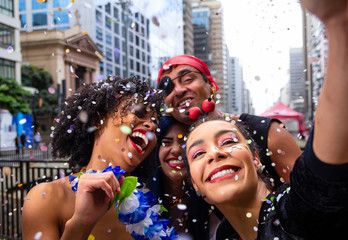 Foto op Aluminium Carnaval Girls taking selfie at street party parade, brazilian carnaval. Group of Brazilian friends in costume celebrating.