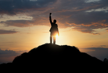 silhouette of man standing on the hill,Business, success,victory,leadership,achievement concept.
