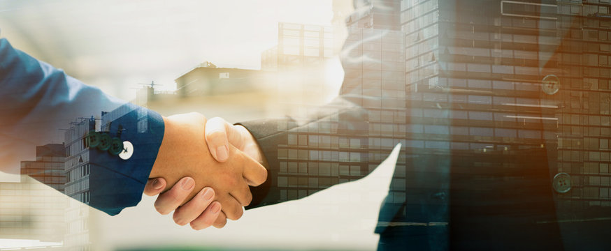 Close up of a business people with a handshake Agreements to do business together show trust and confidence in the investment in real estate. copy space of banner