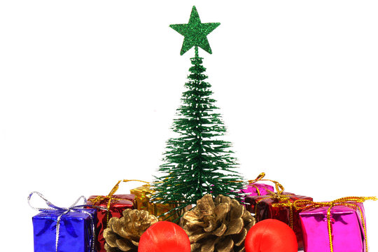 X-Mas or Christmas tree and many present boxes isolated white background and copy space - holiday end of year , new year party , christmas day