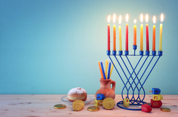 religion image of jewish holiday Hanukkah background with menorah (traditional candelabra),...
