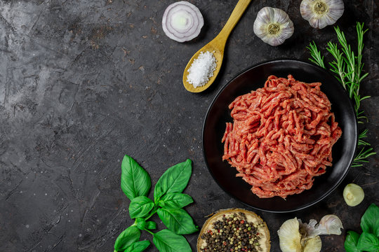 Minced meat. Shredded meat on a black background. Top view