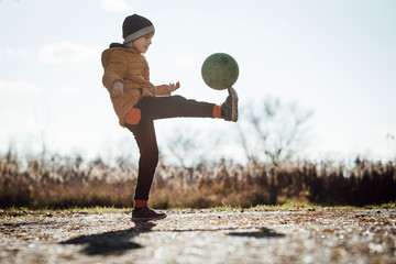 Young boy playing football outdoor