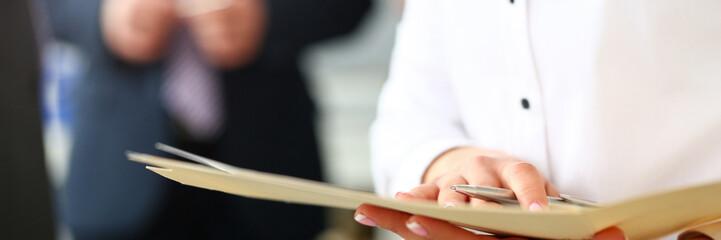 Female hands holding manila folder with important document