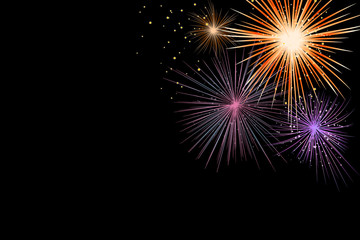 abstract show group of exploding fireworks bright light vibrant colorful and falling fire glitter confetti on black background for happy new year,diwali,labor's day ,independence's day concept
