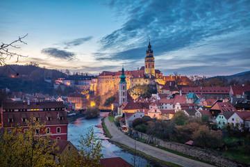 Cesky Krumlov, Czechia. Cityscape at dusk with Krumlov Castle and Vltava river
