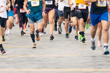Marathon runners. Marathon running race in city streets.