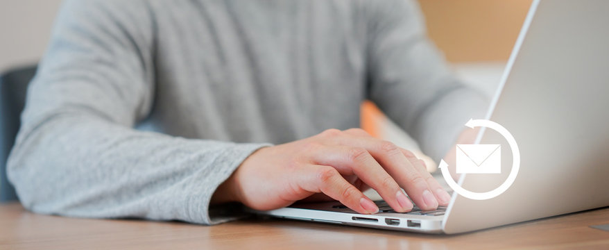 close up employee businessman hand typing content on email marketing and sending  to partner and customer with virtual interface icon for global financial and business concept