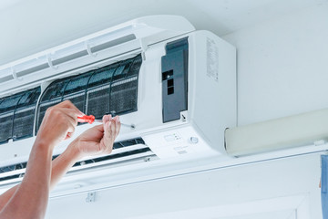 Air conditioner repairing by technician