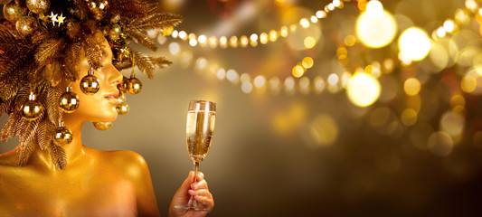 Beauty Glamour Golden Christmas Woman celebrating with champagne, wearing wreath decorated with...