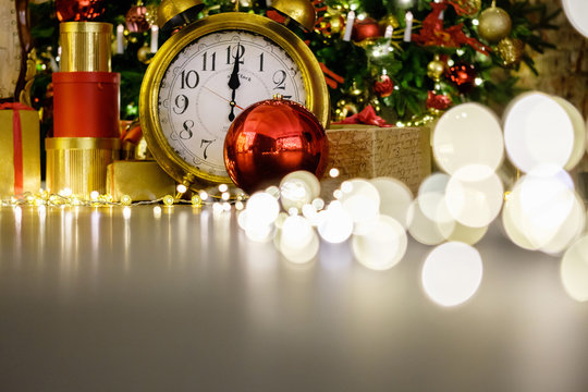 Beautiful Christmas decorations watches gifts toys and a led garland with warm white light on a background of a beautiful elegant New Year tree. Christmas and New Year concept. Copyspace
