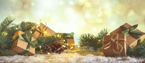 Christmas and zero waste, eco friendly packaging gifts in kraft paper on a wooden table, eco...
