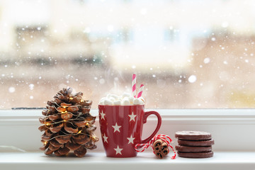 Autocollant pour porte Chocolat Red cup of hot chocolate drink with marshmallows and cone, cookies, cinamon in front of a window.