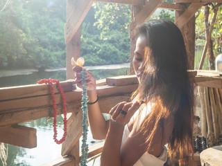 Thai girl as a friend of Paul Gauguin posing for an artist in Thailand