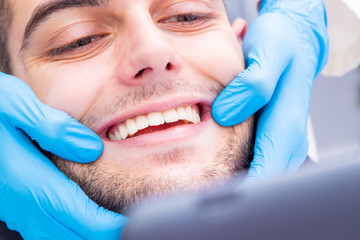 dentist showing the patient's smile or teeth