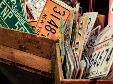 reproductions of American automobile license plates for sale in a flea market