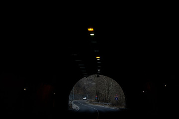 Papiers peints Tunnel End of the tunnel in mountains in Bulgaria, car road through the rocks, entrance, dark surrounding walls and light on top