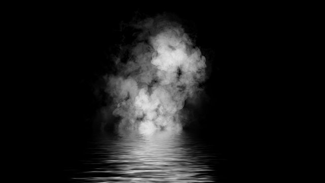 Mistery coastal fog .Smoke on the shore . Reflection in water.