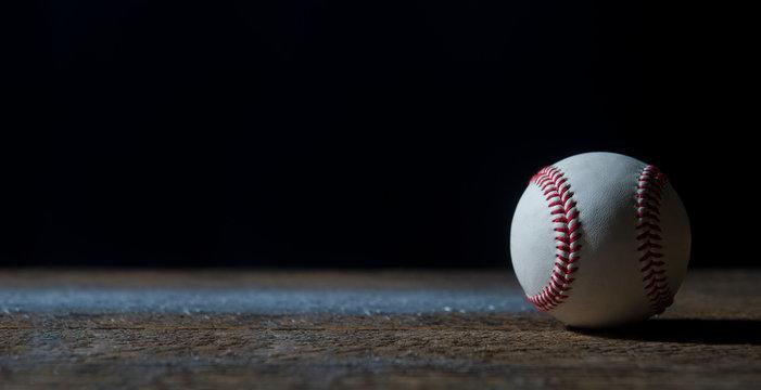 Baseball Ball On Wooden Table. Team sport