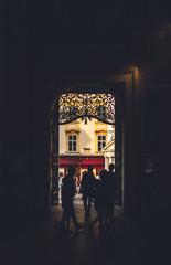 Silhouette of people walking in a street in Vienna
