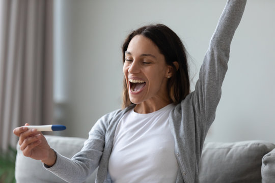 Woman use pregnancy test see two stripes celebrating feels happy